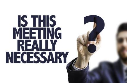 Business man pointing the text: Is This Meeting Really Necessary?